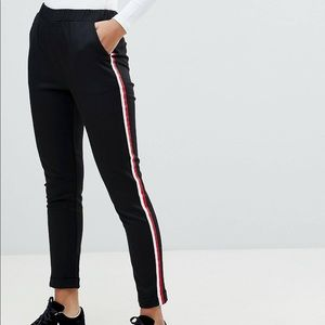 Trouser pants with red side stripe